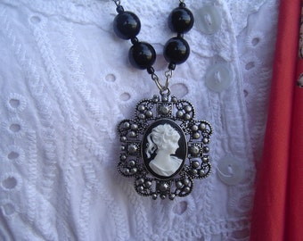 GOTHIC CAMEO ONYX black necklace.Quality onyx beads keep this piece simple.The medallion style of cameo retains a vintage feel for all ages.