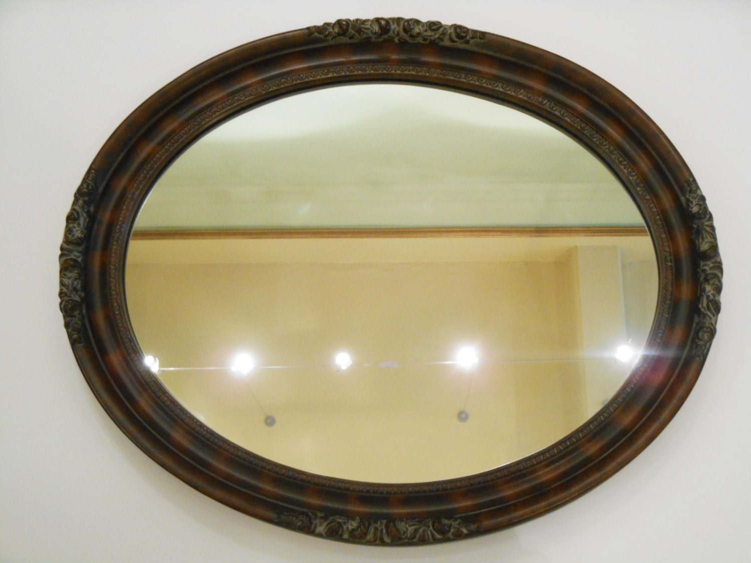 Oval Mirror Framed In Wood With Florettes