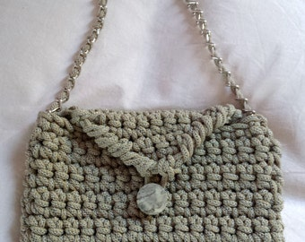 Delicious beige clutch bag with button