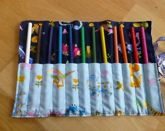 Dinosaur Child's pencil roll containing 12 pencils