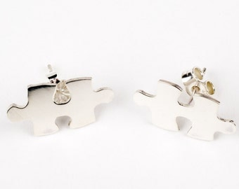Sterling silver puzzle earrings with stud fitting..