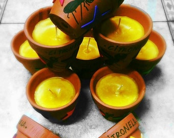 Citronella ceramic jar candles, ideal for your garden.