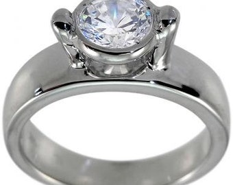 Solitaire Engagement Ring In 14k White Gold With A Bezel Set Diamond Ring Design