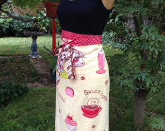 Colourful towelling half apron with cafe motifs and pen pocket