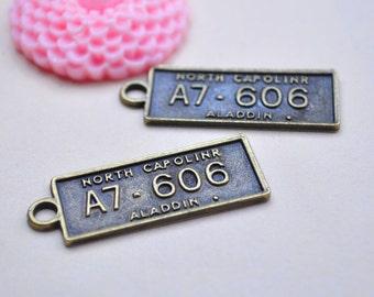 Antique Bronze License PLate Charms.15pcs Aladdin North Capolinr Plate Charm Pendants 36x13mm