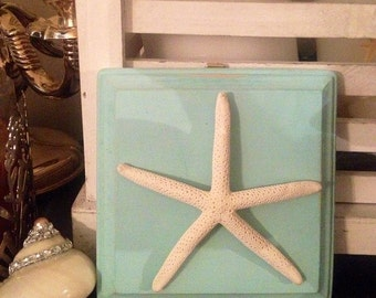 blue wall plaque with white starfish. shells, seashells, starfish, home decor, beach decor, beach house, wall hanging, kids room, bathroom