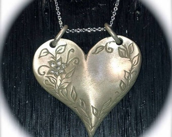 Hand Engraved Sterling Silver heart necklace with diamonds.