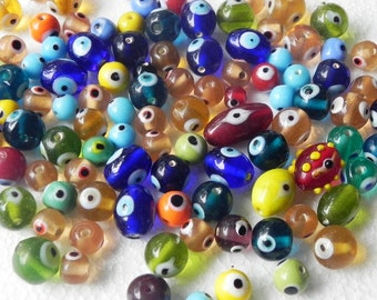 SUPPLIES-beads -  80 Pcs Lampwork multy colour design eyes Beads handmade in Focal oval shape