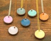 Enameled lucky penny pendant necklace.