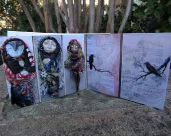 Mini Art Book with a great coupon. Images of Paintings & Bohemian Art dolls by Griselda Tello.