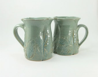 pair of leafy green mugs