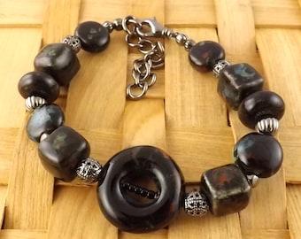 Black pottery bead adjustable gunmetal bracelet
