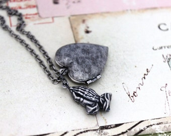 prayer. locket necklace. silver ox with etched lines heart