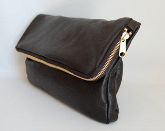 Fold over clutch in black // gold tone hardware