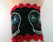 Day of the Dead (el Dia de los Muertos) embroidered cloth cuff bracelet. Black cloth, red floral trim. Colorful.
