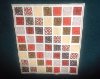 Child's quilt 38x33 oranges and Browns. 100% cotton