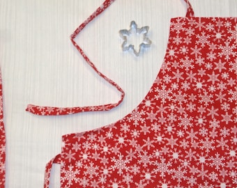 Child size apron - snowflakes red white reversible - snowflake cookie cutter