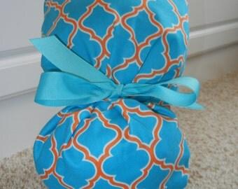 Turn Up Ponytail Scrub Hat in Turquoise Orange Lattice Quatrefoil