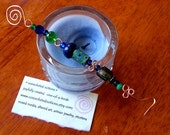 handcrafted copper candle snuffer with vintage glass and antique trade beads