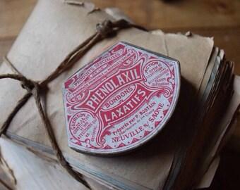 Ancienne petite boîte en carton rouge et doré curiosité médicament laxatif remède pill box french