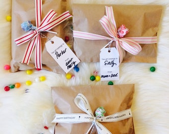 Gift wrap. Craft paper bag, cotton ribbon and gift tag.