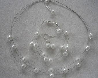 Pure Snow White Floating Infinity Pearls Necklace Bracelet and Earrings Set.