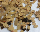 New item -- 7g of 8x5 mm Side Hole Oval Sequins in Metallic Gold Color (approximately 780 ct.)