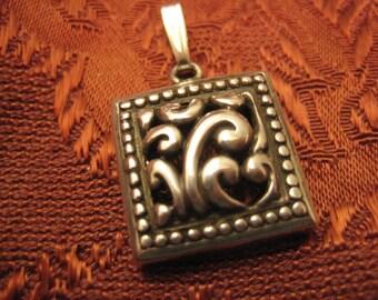 Sterling silver pendant Asian puffed pattern