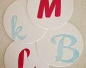 Set of twelve custom monogram letterpress coasters