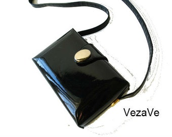 Luxurious vintage 80as black , glossy patent leather, box style purse with a long handle-strap. Made by Ande.