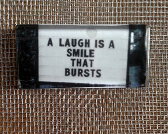 A smile is a laugh that bursts..large glass magnet