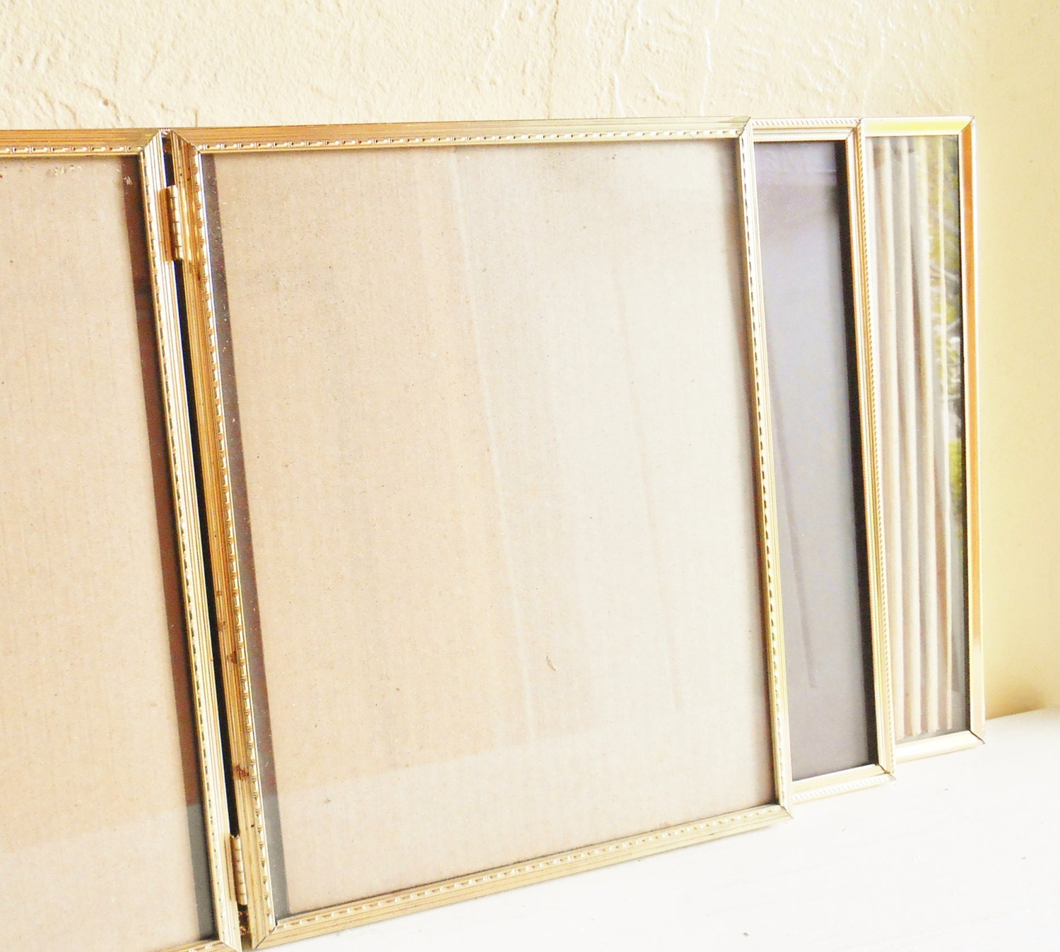 three 3 folding 8x10 gold metal picture frames with glass