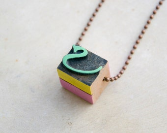 Vintage wooden typographic necklace. Antique copper chain. Letter S green yellow pink wood