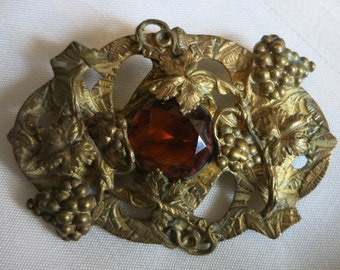 A Decorative Antique Brooch In Gold and Silver Tone with a Cut Glass Stone in Topaz