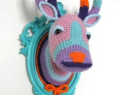 Crochet deer head in a turquoise frame.