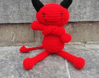 A crochet devil doll