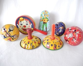 vintage noise makers, tin lithographs, Kirchhof noisemakers, wooden handles, dancers, clowns, vintage toys