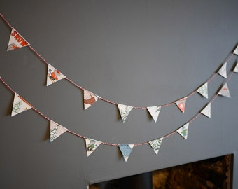 Paper Garland. These gorgeous paper garlands are made from an old Barber Children's Book.