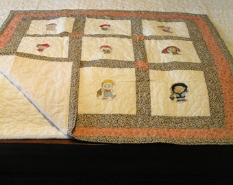 Handmade Baby quilt features embroiderd children of the world