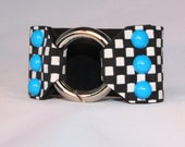 Neon Blue dommed rivets on Black and White Checkered Leather Cuff