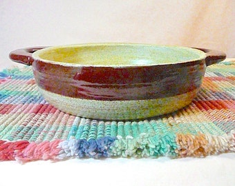 STURDY CASSEROLE DISH ,safety handles....free pendant with each order