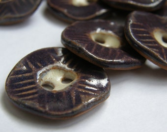 Textured purple hexagon buttons
