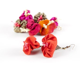 Red fabric dangles in smart flower shaped design