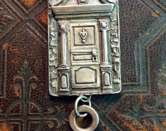 Door pendant England finished necklace in sterling silver.