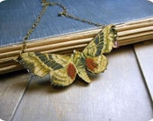 The Luna Moth Necklace. Yellow Spring Moth Necklace with peachy pink czech glass bell flower. Rustic brass necklace