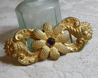 Vintage buckle with shells and flower set with amethyst glass cabochon circa 1940's
