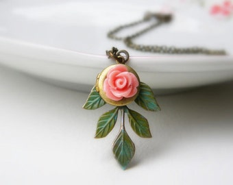 Emily. Leafy drop pendant with coral pink rose and locket