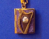 Celtic Harp Love Locket, purple and gold, holding 14 ways to tell someone you love them, from English to American Sign Language