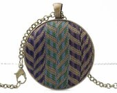 Womens boho necklace features rustic pendant with multicolored fabric - metallic bronze accessory - antiqued metal jewelry for her