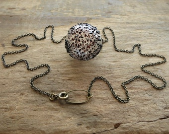 Speckled Glass Bubble Necklace, clear blown glass orb with brown textured spots on brass chain, rustic modern jewelry